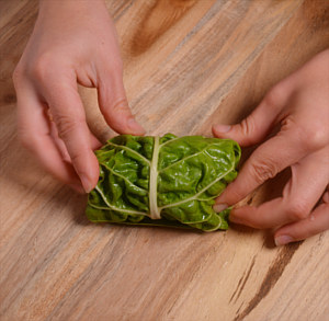 Rolling the swiss chard rolls