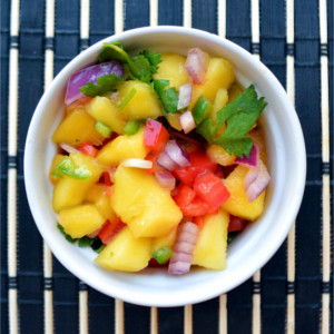 Tropical Mango Salsa - Delicious dip for tortilla chips or topping for chicken, burgers and fajitas!