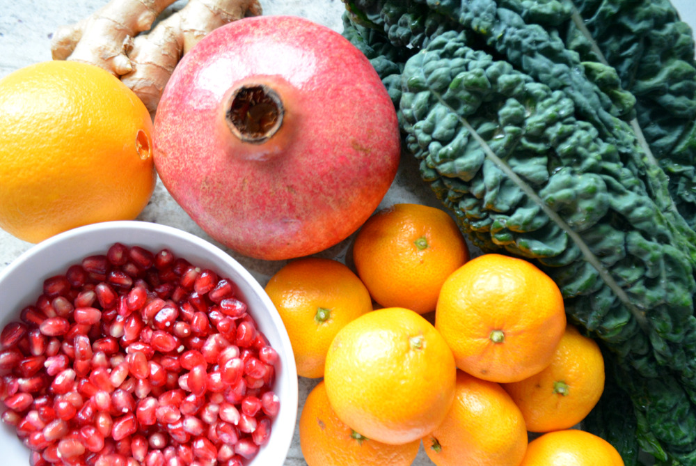 Pomegranates, mandarin oranges, ginger and kale - perfect ingredients for a festive and healthy holiday salad!